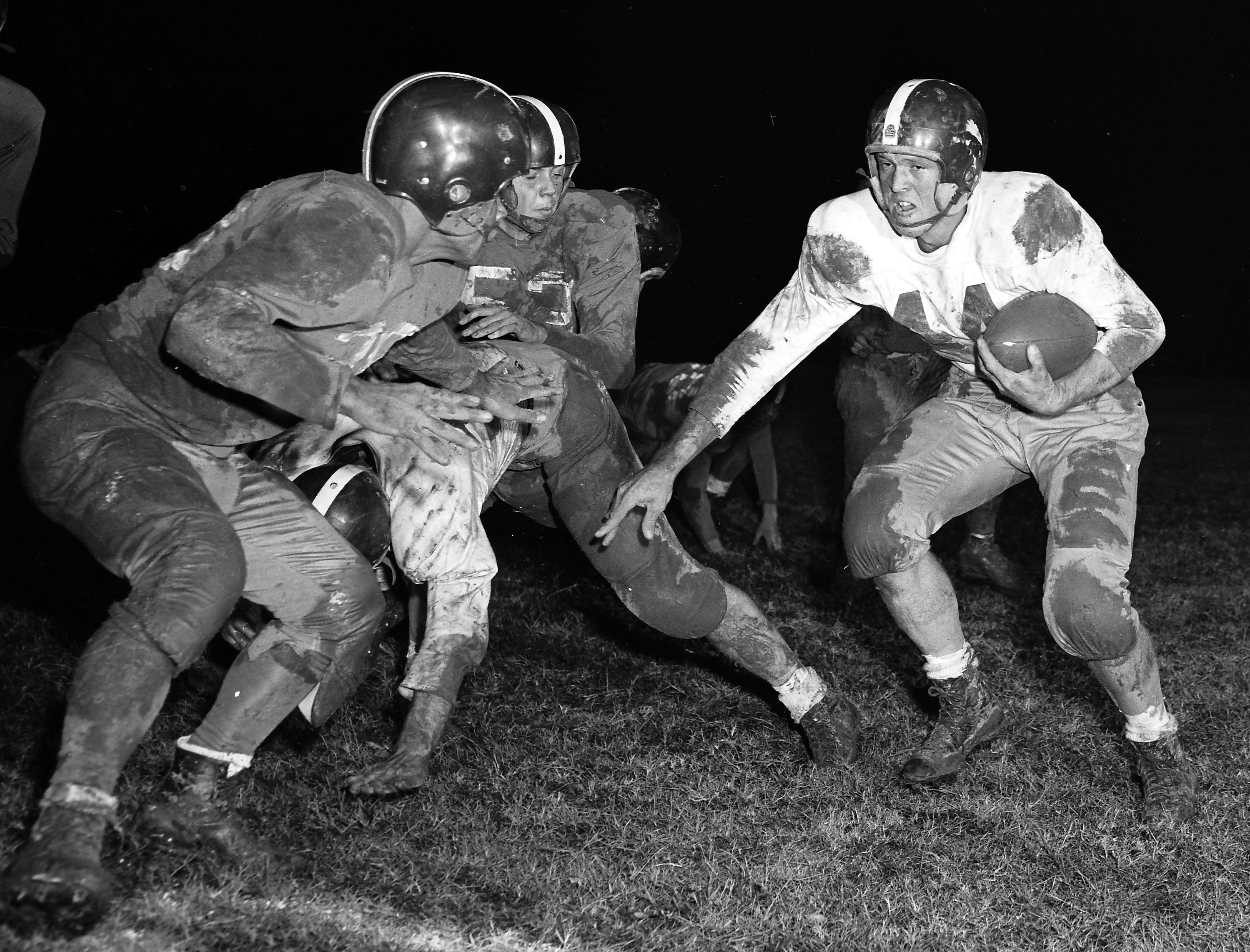 South Side's Marvin Throneberry (Right) is cornered by Catholic High's John Burnette, but not until after Thorneberry had ripped off a sizable gain that set up his 21-yard touchdown run.  The Scrappers won 32-7 on 14 Nov 1951.