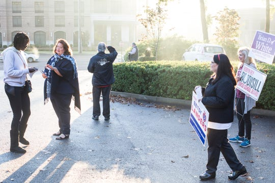 November 06 2018 - People campaign outside of a voting location at Riveroaks Reformed Presbyterian church in Germantown on Election Day.