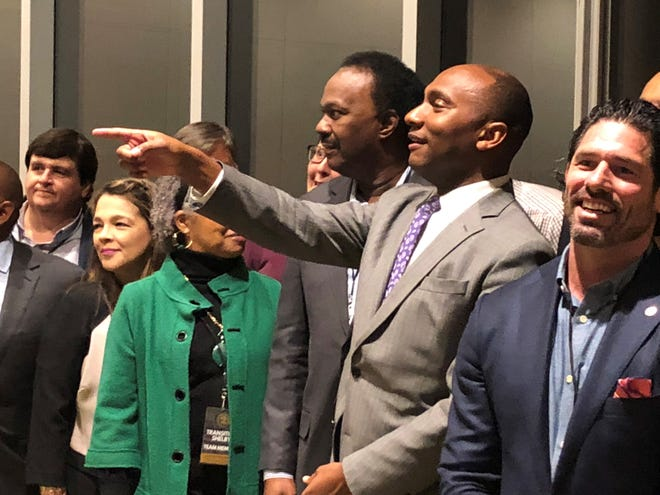 Shelby County Mayor Lee Harris prepares for a group photo Monday with members of his transition team.