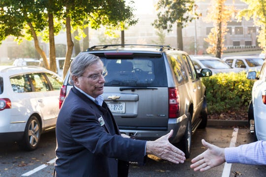 November 06 2018 - Germantown mayoral candidate John Barzizza shakes hands with a voter outside of a voting location at Riveroaks Reformed Presbyterian church in Germantown on Election Day.