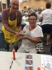 Joanna Pepi, with Bingo Committee member Joe Atkin, was JCMI's big winner at Monday Night Bingo.