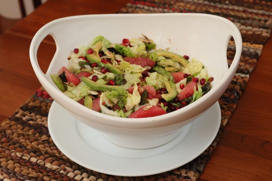 Avocado Grapefruit Salad made by Karen Bate lends a fresh accent to the Hoffes' Thanksgiving dinner.