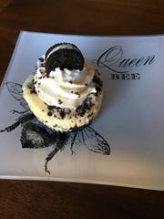 This Oreo-topped mini cheesecake is artfully presented.