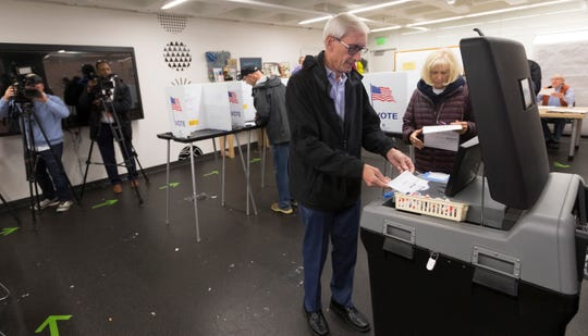 Democratic candidate for governor Tony Evers and his wife, Kathy, vote Tuesday, Nov. 6, 208, at the central branch of the Madison Public Library in Madison, Wisconsin.