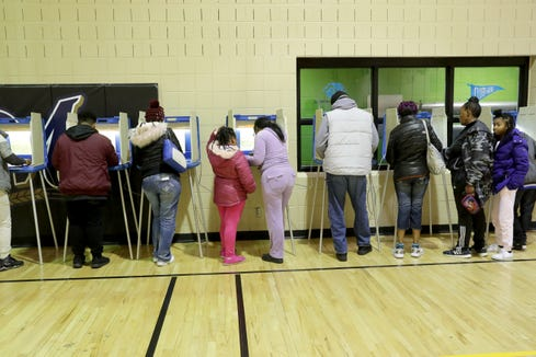 People vote at the Boys and Girls Club in Sherman Park in Milwaukee.