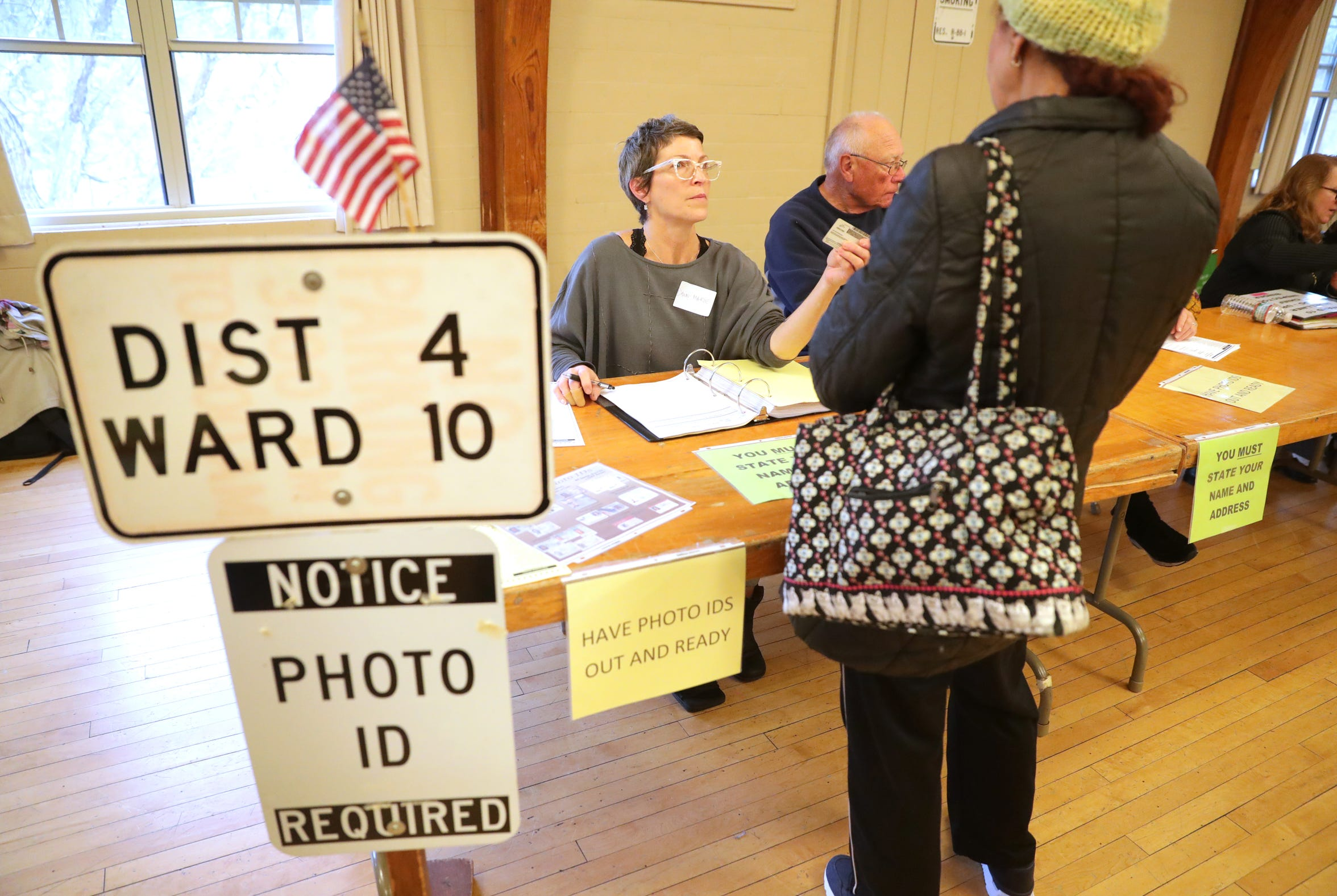 Poll worker Dawn-Marie Metz, checks voters identification at the Hart Park Senior Center in Wauwatosa. Voter ID was required for all those wanting to vote. Citizens cast their vote for the midterm election.