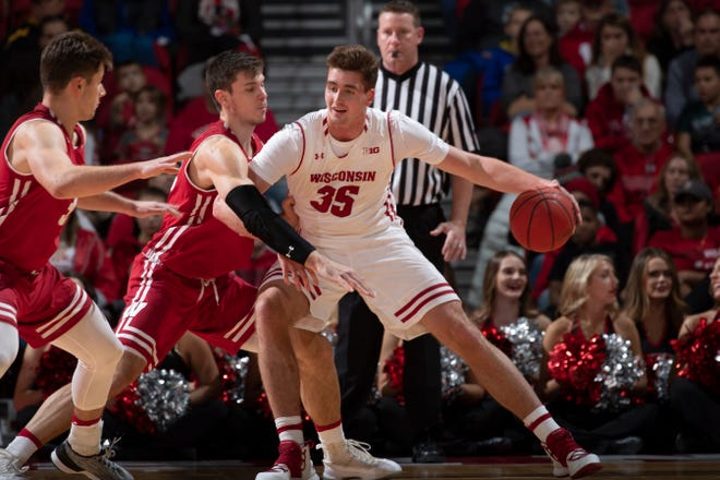 Nate Reuvers battles against Ethan Happ in a intrasquad scrimmage last month.
