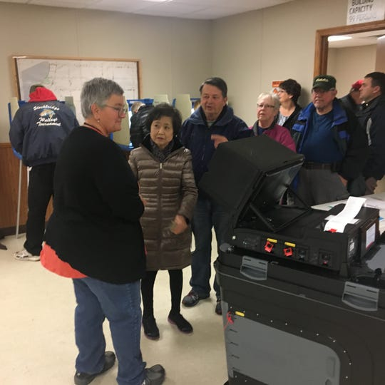 About 20 voters were in line at the Calumet Town Hall in Fond du Lac County when the polls opened Tuesday morning.