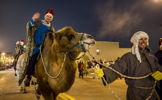 Blase Strobl guides the camal for Ben Bobowski for Grace Lutheran Church as they dress up from the days of the birth of Christ in the 2016 Menomonee Falls Christmas Parade.