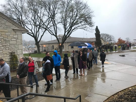 Dozens of people stood in line at the Hart Park Senior Center in Wauwatosa when the polls opened at 7 a.m. Tuesday.