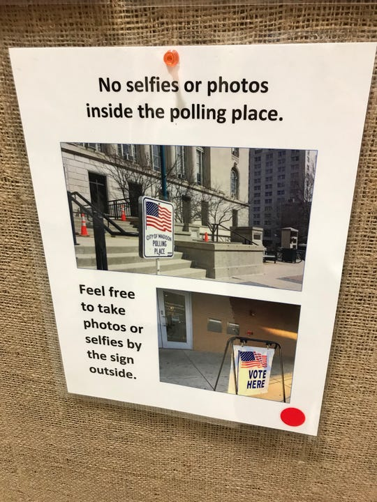 This sign was tacked on a bulletin board outside a polling spot at Memorial Union on the UW-Madison campus.