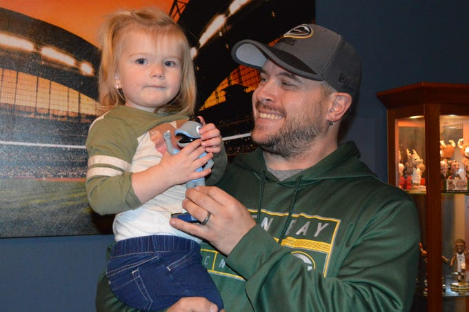 John Jastroch has already gotten his 2-year-old daughter, Riley, into collecting bobbleheads.