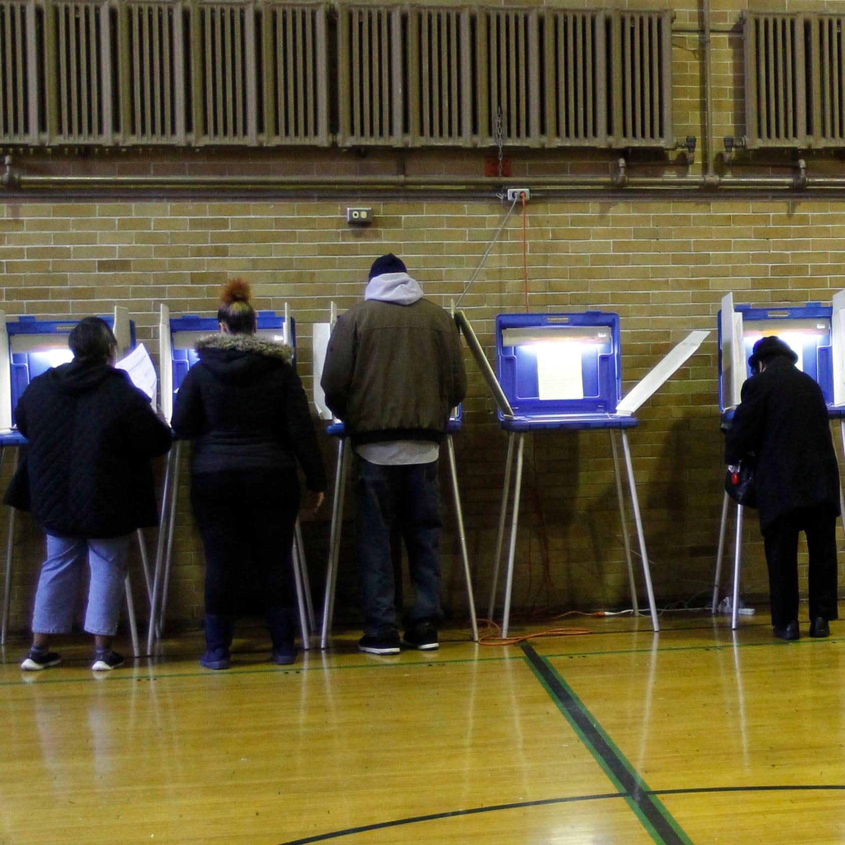 Liberal groups ask judge to overturn early voting limits Gov. Scott Walker signed last week as part of lame-duck legislation