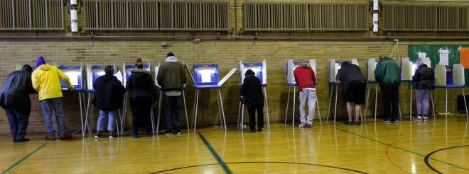 Nearly every voting booth is occupied as residents vote at Sherman Multiculural School in Milwaukee on Nov. 6. Liberal groups went to court Monday to block new Republican legislation Gov. Scott Walker signed Friday that would limit early voting.