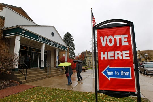 Voters brave chilly and wet weather to  vote at the Community Center Gym in Cedarburg.