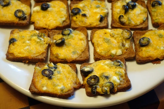 Olives top Rob Kujawski's cheesy Rye Bread Treats, which also have chopped hard-cooked egg.