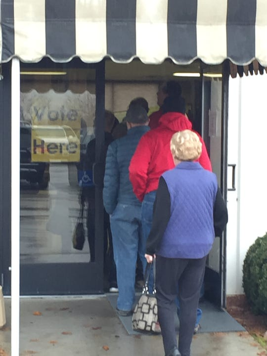 Voters wait in line at the Hartford Town Hall.