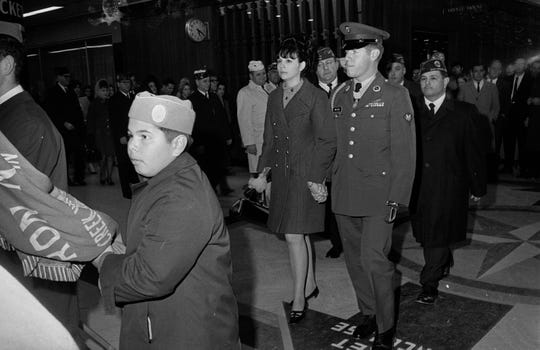 South Milwaukee native Gary Wetzel is greeted by a reception committee at Mitchell International Airport after receiving the Medal of Honor in Washington on Nov. 20, 1968. With him is his fiancee, Bonnie Cline.