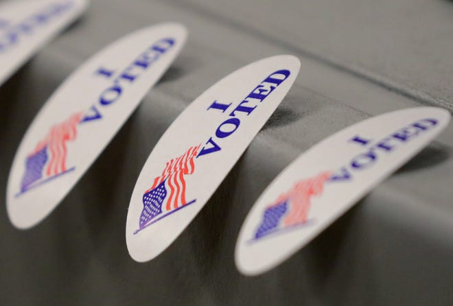 """""""I Voted"""" stickers wait for voters after they cast their ballots."""