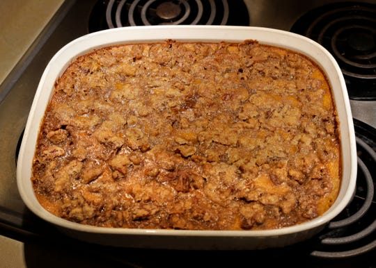 Bourbon sweet potato casserole has bourbon in the mash and bourbon-soaked pecans in the brown sugary topping.