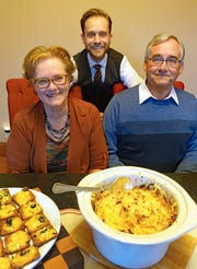 Rob Kujawski (rear) hosts Thanksgiving dinner every year at his Brookfield home, with help from mom Sybil and dad Robert.