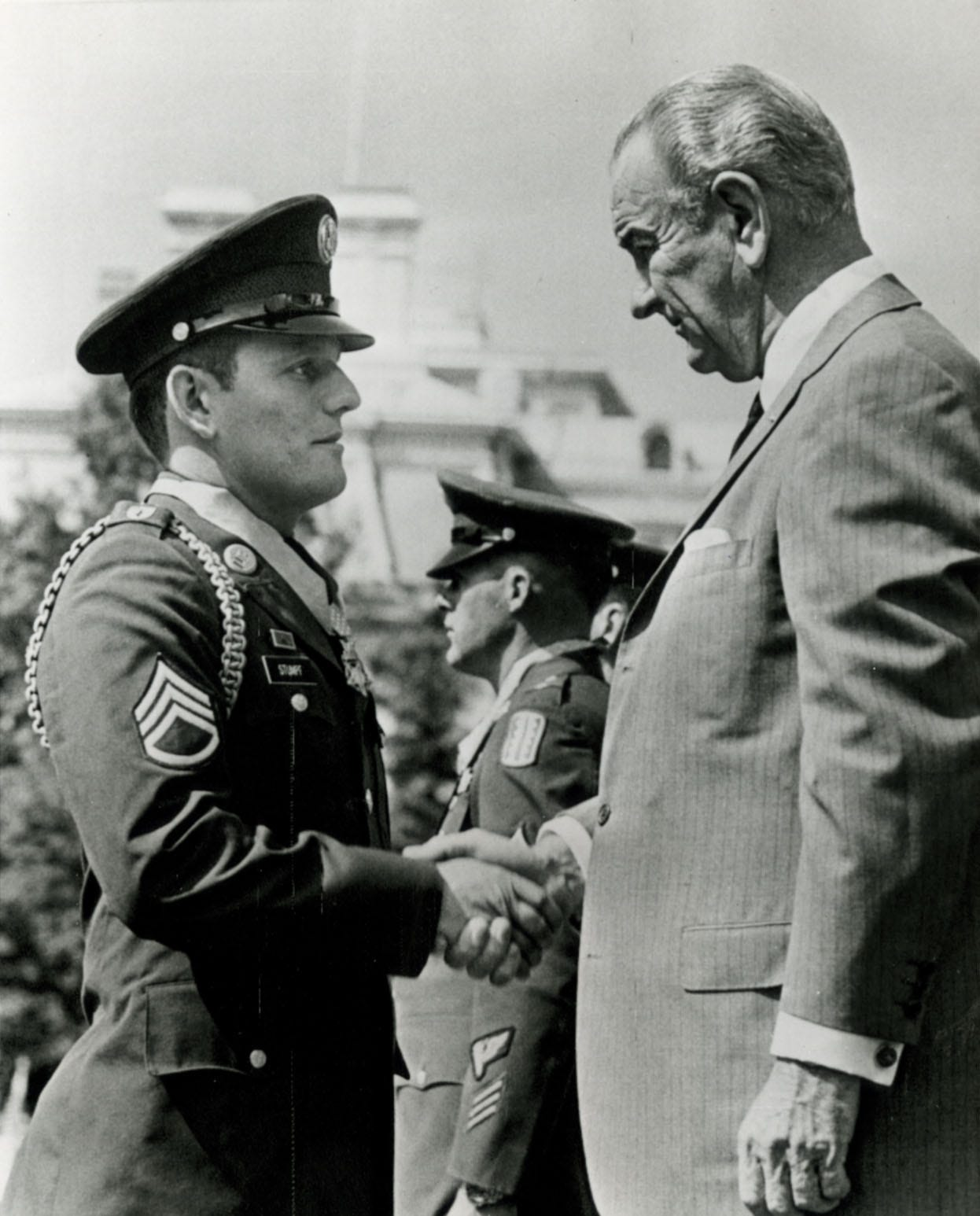 President Lyndon Johnson shakes hands with Staff Sgt. Kenneth Stumpf of Menasha on Sept. 19, 1968, after presenting him with the Medal of Honor in a White House ceremony.