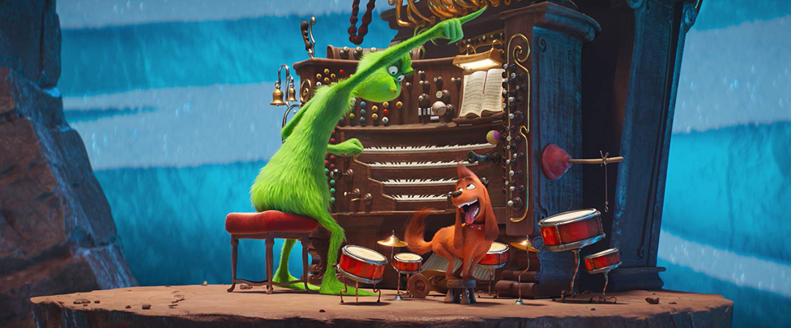"Benedict Cumberbatch voices the Grinch (shown ordering about his faithful dog, Max), in ""The Grinch."""