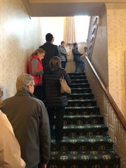 Voters wait in line at the Wauwatosa Women's Center early Tuesday morning.