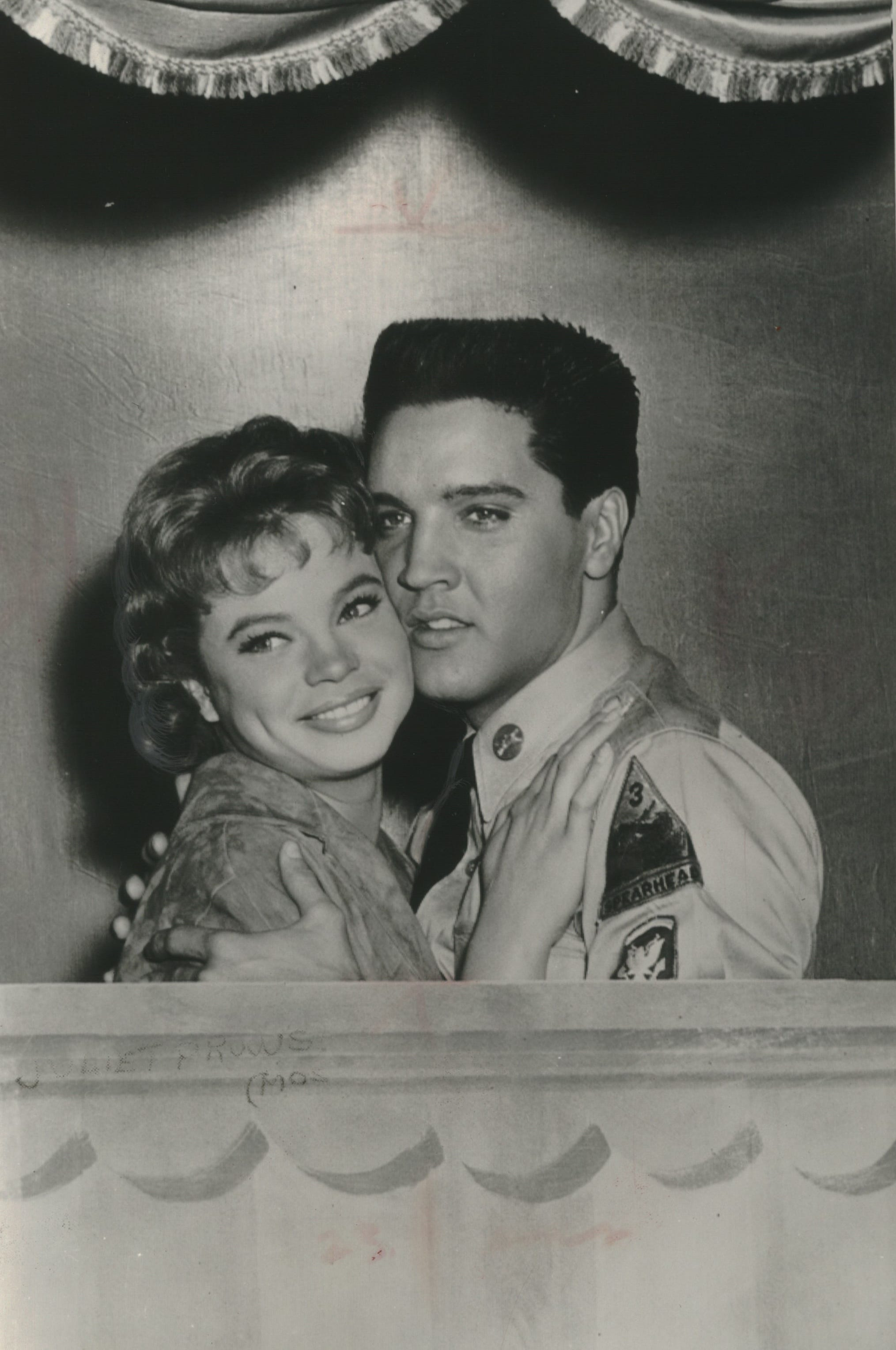 "Juliet Prowse shares a clinch with Elvis Presley in the 1960 musical ""G.I. Blues."""