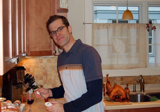 Jason Hoffe prepares to carve a turkey.