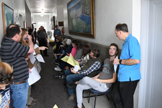 Would-be voters fill up the Baxter County Courthouse hallway on Tuesday afternoon.
