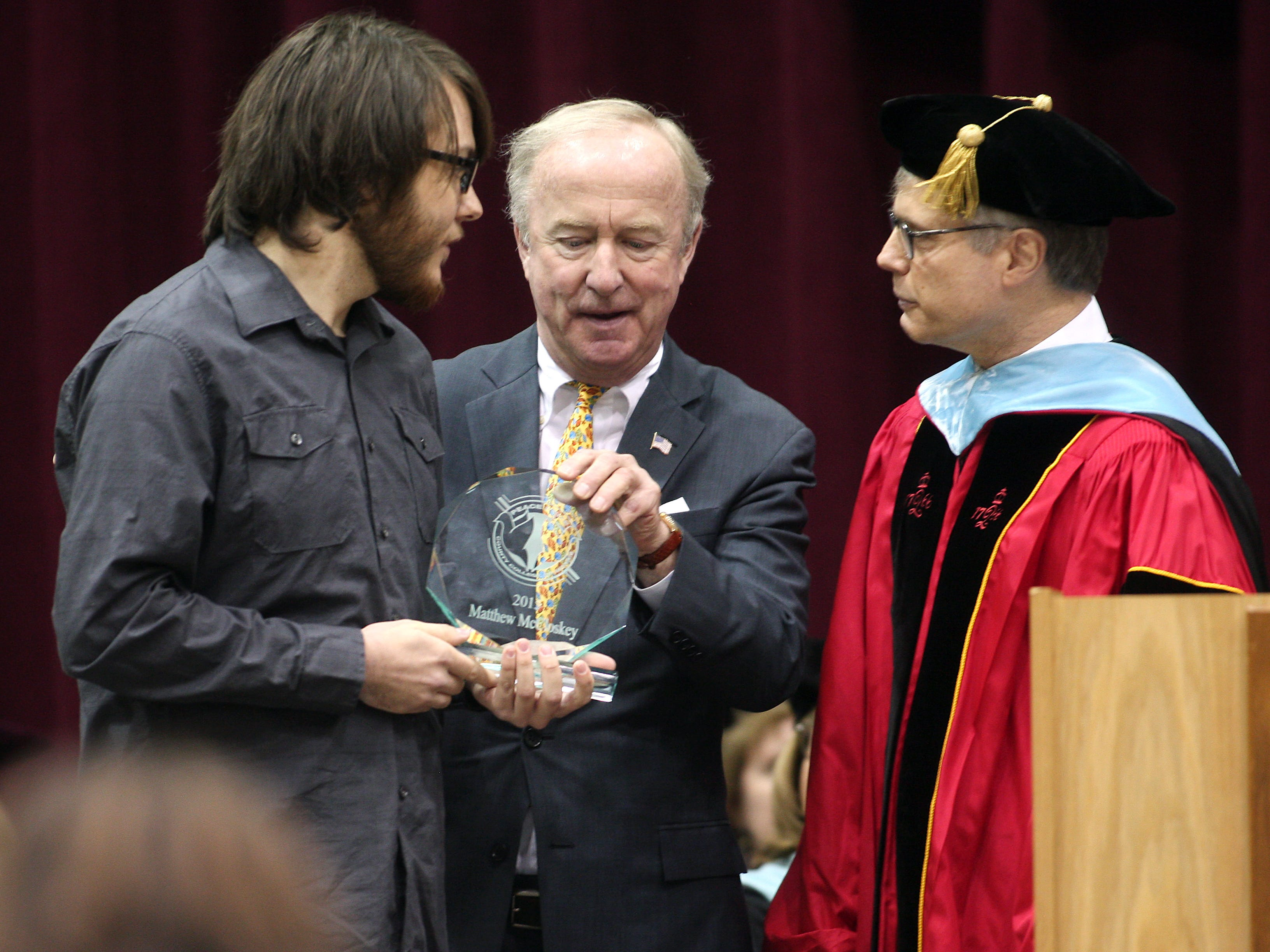 VP of Academic Affairs Dr. Dwight Smith and Congressman Rodney Frelinghuysen present the County College of Morris Peace Prize to Matthew McColoskey during the 46th Commencement Ceremony. May 22, 2015. Randolph, N.J. Bob Karp/Staff Photographer.