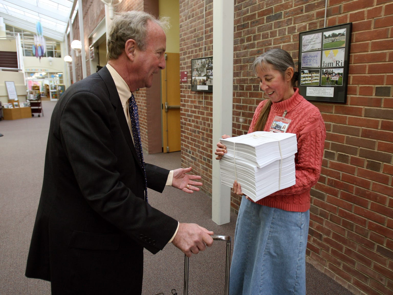 Morris Twp--Oct 30, 2009--Congressman Rodney Frelinghuysen delivers the nearly 2000 page health care reform bill to the Director of the Morris County Library Lynne Olver. (cq)
