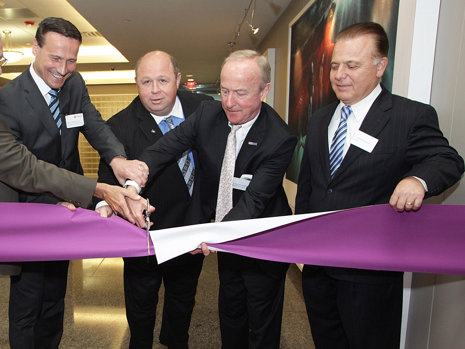 Parsippany -- 05/14/2012 -- Evonik Degussa Corporation dedicates their new administration center -- Participating in the ceremonial ribbon cutting: Tom Bates, Evonik Degussa Corporation President, Evonik Industries AG Board Member Patrik Wohlhauser, Parsippany Mayor James Barberio, Congressman Rodney Frelinghuysen and NJ State Senator Joseph Pennacchio.