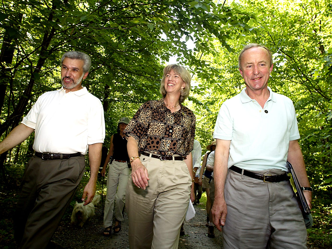 Rockaway Twp--May 22, 2004--Mayor of Rockaway Twp Lou Sceusi, l, US Secretary of the Interior Gale Norton and Congressman Rodney Frelinghuysen walk up to a lookout at Wildcat Ridge for a news conference about the Highlands.