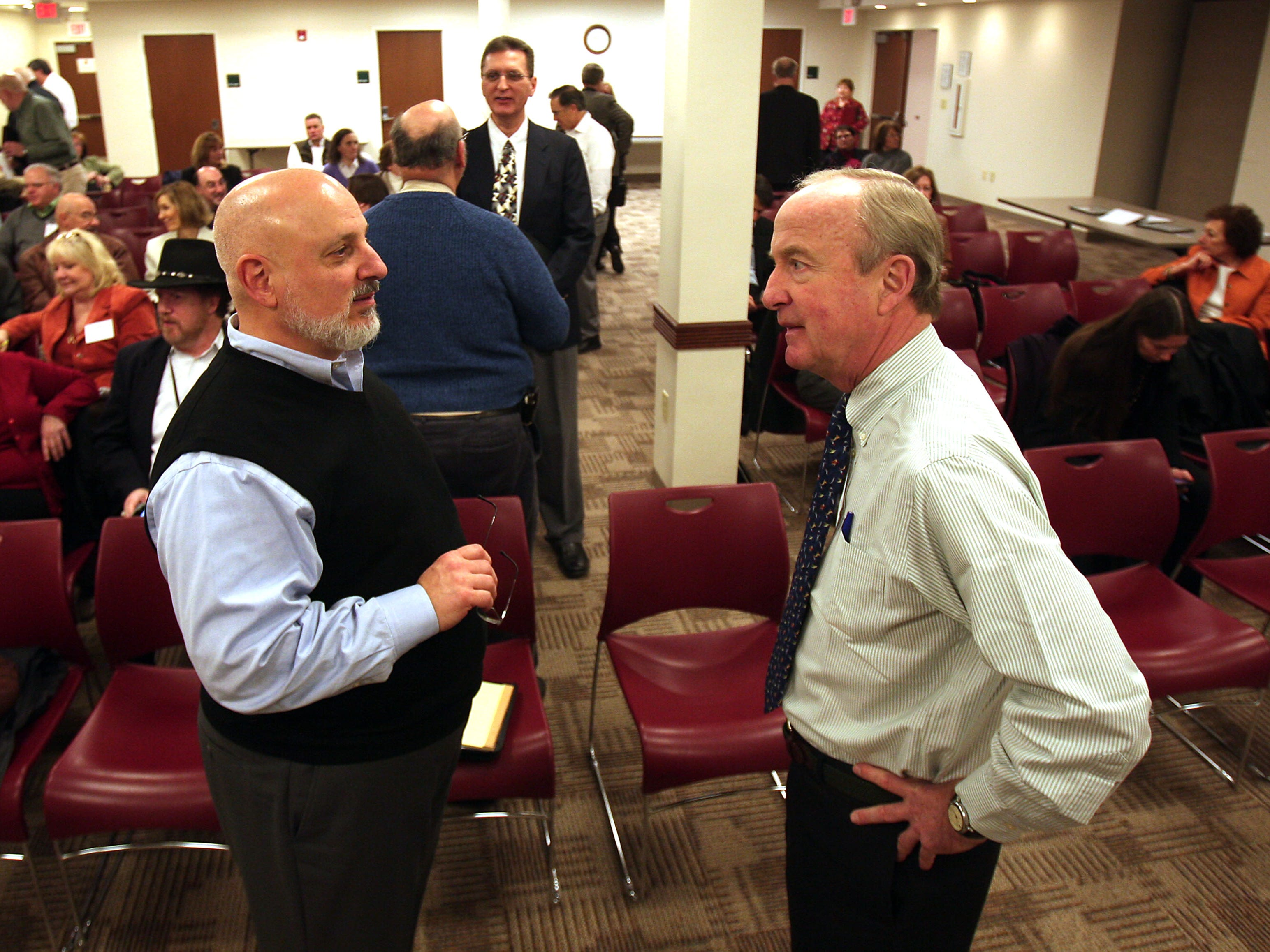 Glenn Nahass of GNPC LLC in Pompton Plains (left) talks with Rep. Rodney Frelinghuysen, who met with members of the Professional Support Group of Morris County at the Parsippany Main Public Library.