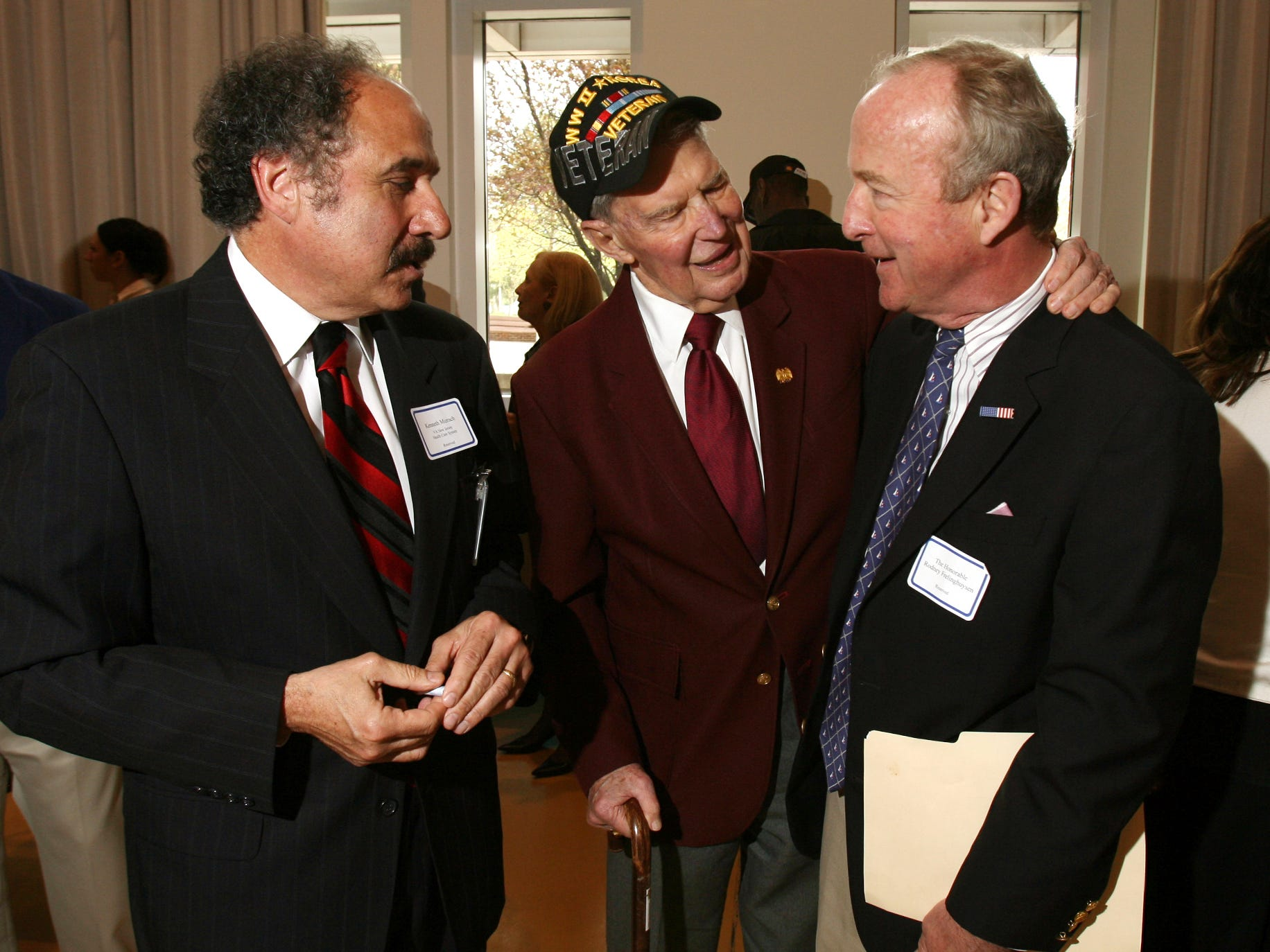 Bernards Twp, April 9, 2010--Bob Tracey, c, of Morristown talks with the Director of VA NJ Health Care System, Kenneth Mizrach, l, and Congressman Rodney Frelinghuysen who officiated at the fifth anniversary of the Hope for Veterans project at the Lyons Veterans Affairs campus.
