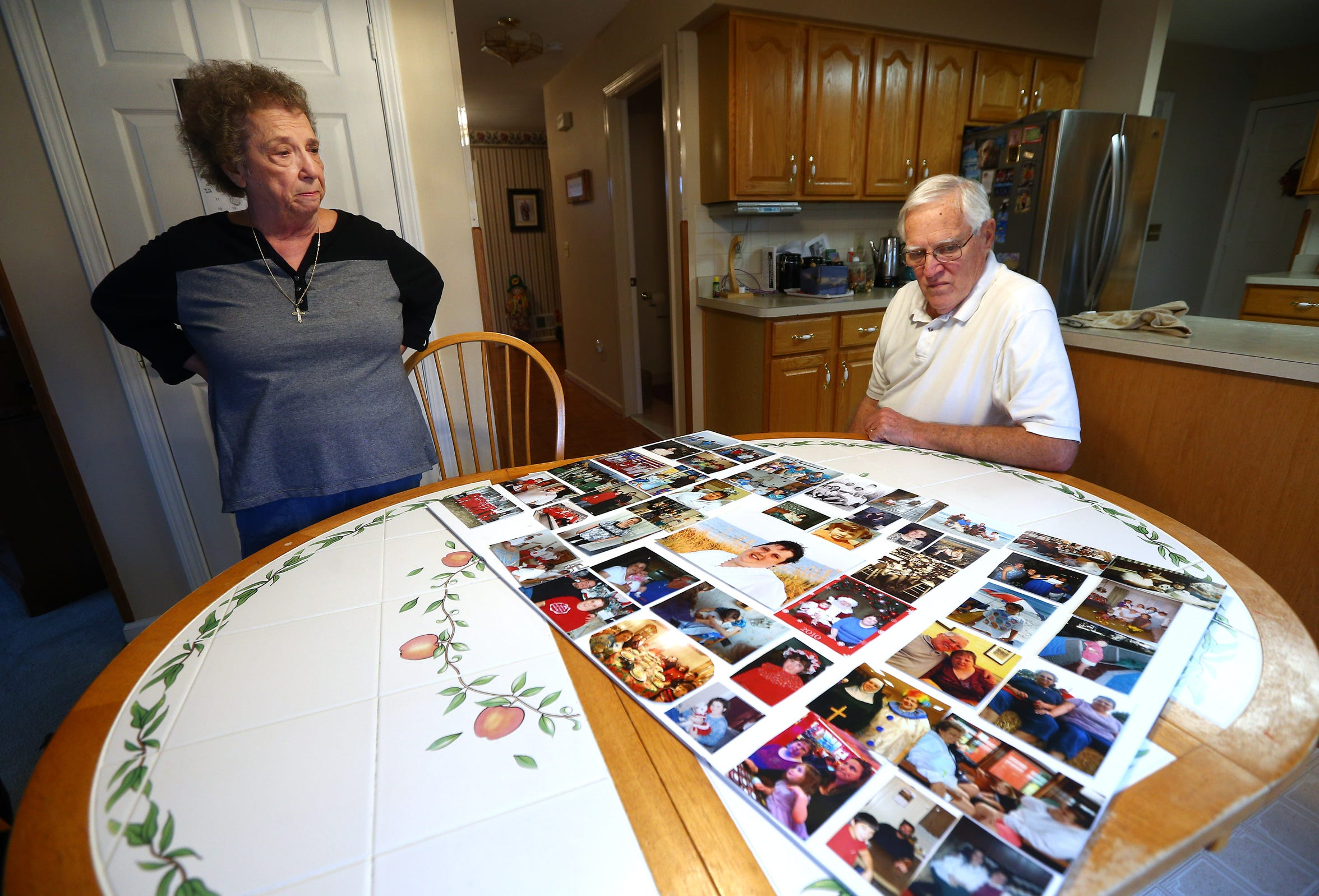 "Margaret and John Murphy with a picture board from their daughter Tara's wake. The parents battled the state for years over the treatment of their developmentally disabled daughter, Tara, who struggled with mental illness in her 30s. The Murphys alleged Tara's civil rights were violated while she was a patient at Ancora Psychiatric Hospital in Winslow Township, Camden County. The state denied all wrongdoing. ""It's been a long road,"" Margaret Murphy said. ""Unfortunately, it would up  the worst that could happen."" November 5, 2018, Toms River, NJ"