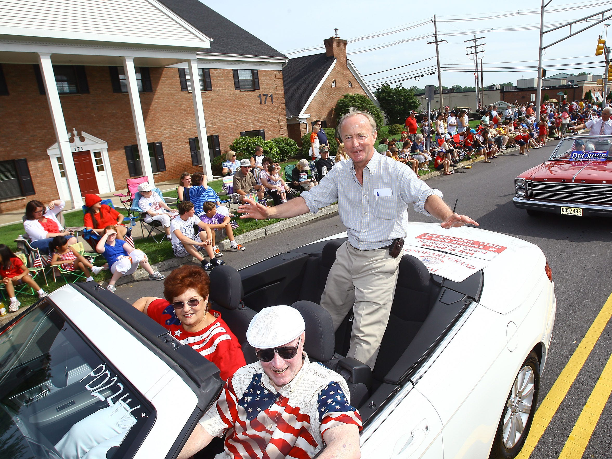 Rep. Rodney Frelinghuysen, R-N.J., waves to the crowd from a car during the parade for the 54th annual Fourth of July celebration Monday in Florham Park.BOB KARP/Staff photoGRAPHER