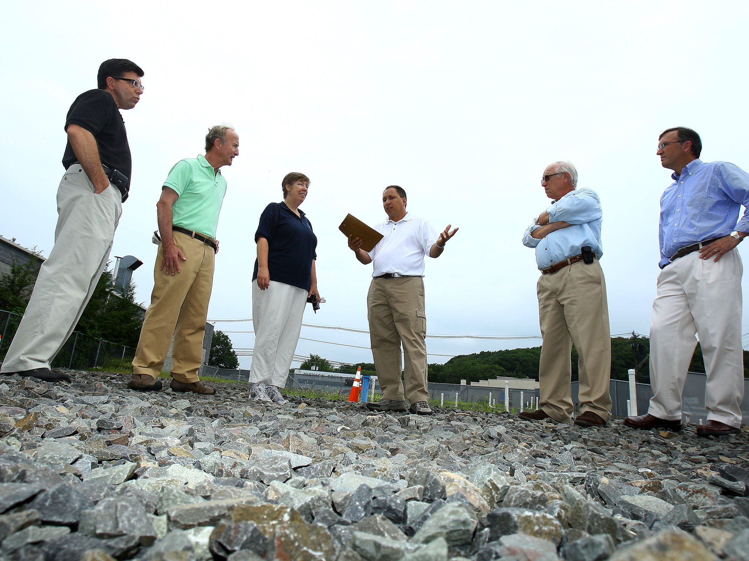 Project Manager for the EPA, Diego Garcia, c, speaks during an annual tour of Superfund sites on Tuesday August 8 in Dover. Asm. Anthony Bucco Jr, l,  Rep. Rodney Frelinghuysen, Judith Enck, Regional Administrator of the US EPA, Len Romino and Steve Maybury of the NJ DEP get a look at the Dover Municipal Well No. 4 