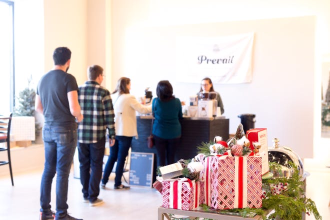 Shoppers line up at checkout at the first ever Pop-Up Shoppe at EastChase in 2017.  The Shoppe will be open starting on Black Friday, and then on Saturdays and Sundays through Dec. 24, and following the hours of 10 a.m. to 7 p.m. on Saturday, and 1 p.m. to 6 p.m. on Sunday.