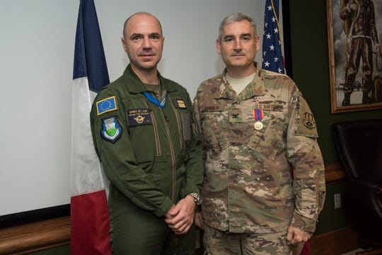 French Air Force Col. Olivier Kaladjian, Air Attaché presents U.S. Air Force Col. Stephen Renner, School of Advanced Air and Space Studies professor, pose for a picture following a medal presentation, Oct. 17 on Maxwell Air Force Base.