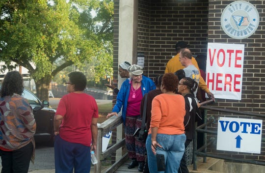 Voters line up at the Houston Hills Community Center in Montgomery, Ala., on Tuesday, Nov. 6, 2018.