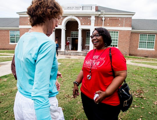 Claudia Mitchell, candidate for Montgomery County School Board District 6, talks with voters outside of the Cloverdale voting station in Montgomery, Ala., on Tuesday November 6, 2018.