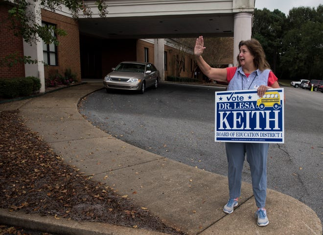 Lesa Keith, candidate for District 1 Board of Education, waves to voters at Dalraida Christ of Church in Montgomery, Ala., on Tuesday, Nov. 6, 2018.