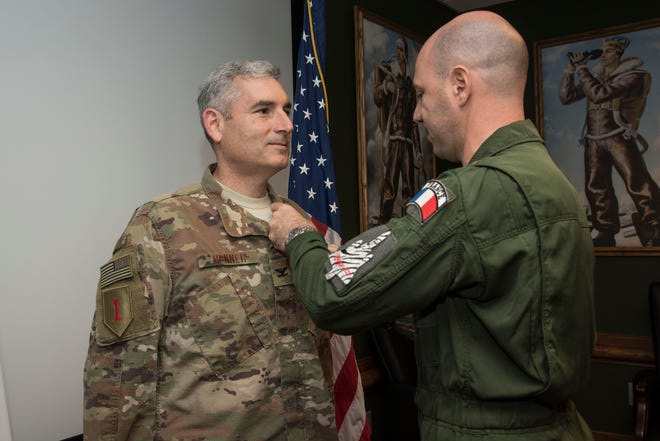 French Air Force Col. Olivier Kaladjian, Air Attaché presents U.S. Air Force Col. Stephen Renner, School of Advanced Air and Space Studies professor, with the French Médaille de la Défense Nationale (National Defense Medal) at the gold level on Oct. 17, Maxwell Air Force Base.