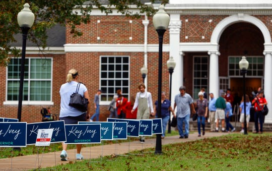 Campaign signs line the sidewalks as large numbers of voters turn out to cast their votes at Huntingdon College Tuesday, Nov. 6, 2018, in Montgomery, Ala. (AP Photo/Butch Dill)