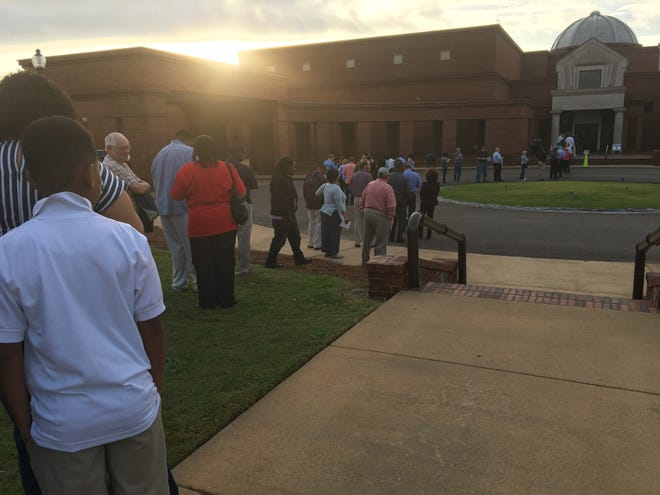 Voters wait for the polls to open Tuesday at the Montgomery Museum of Fine Arts.