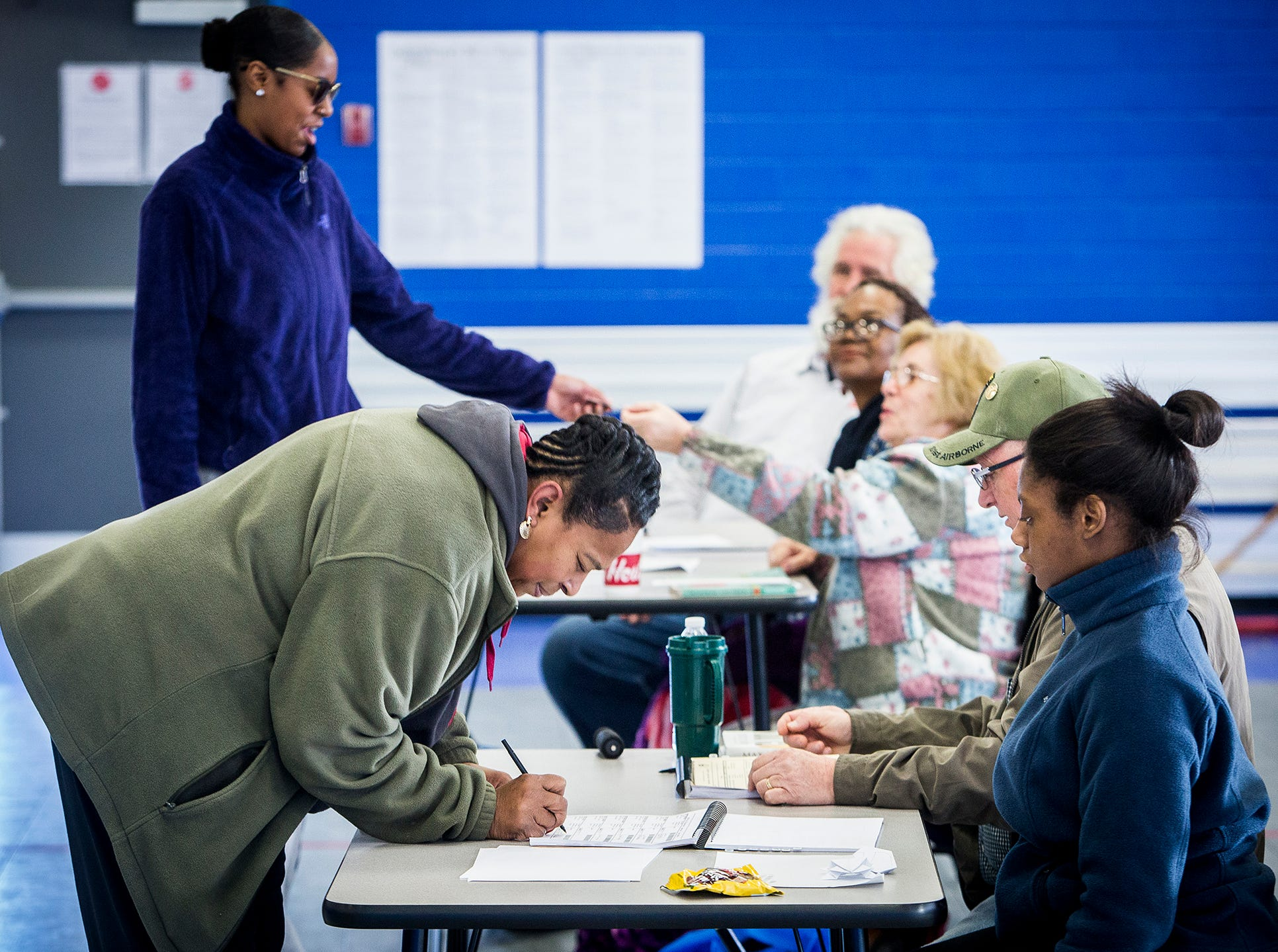Voters from Precinct 19 cast their ballots at the Muncie Boys and Girls Club Tuesday.