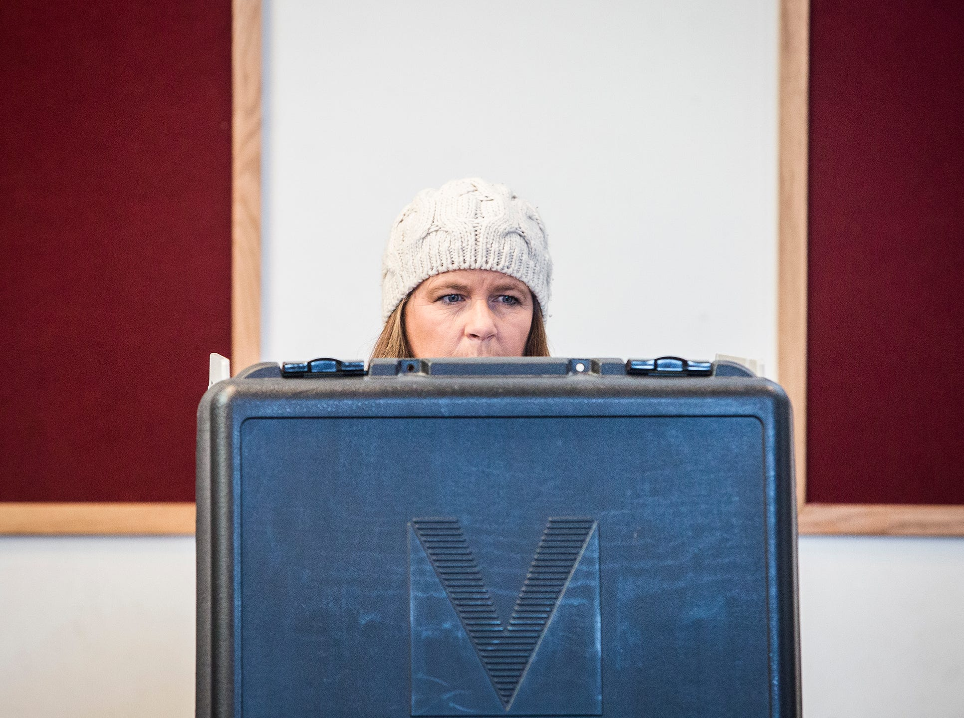 Christa Conway casts her vote at Cornerstone Brethren Church on Cowan Road Tuesday.